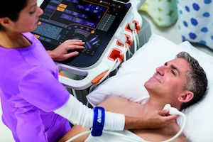 Sonographer holding a transducer