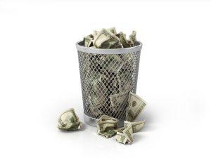 money in a wastebasket