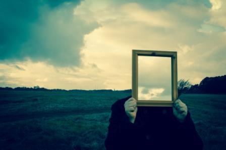 A man holding a mirror