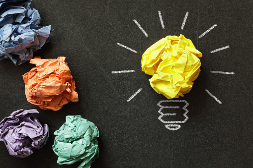 Image of innovation with lightbulb made of paper