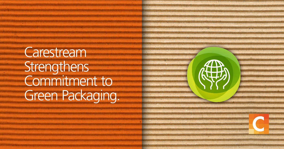 "Cardboard backgroud - Half of it is in orange preset with text ""Carestream Strengthens Commitment to Green Packaging with a sustainability icon"