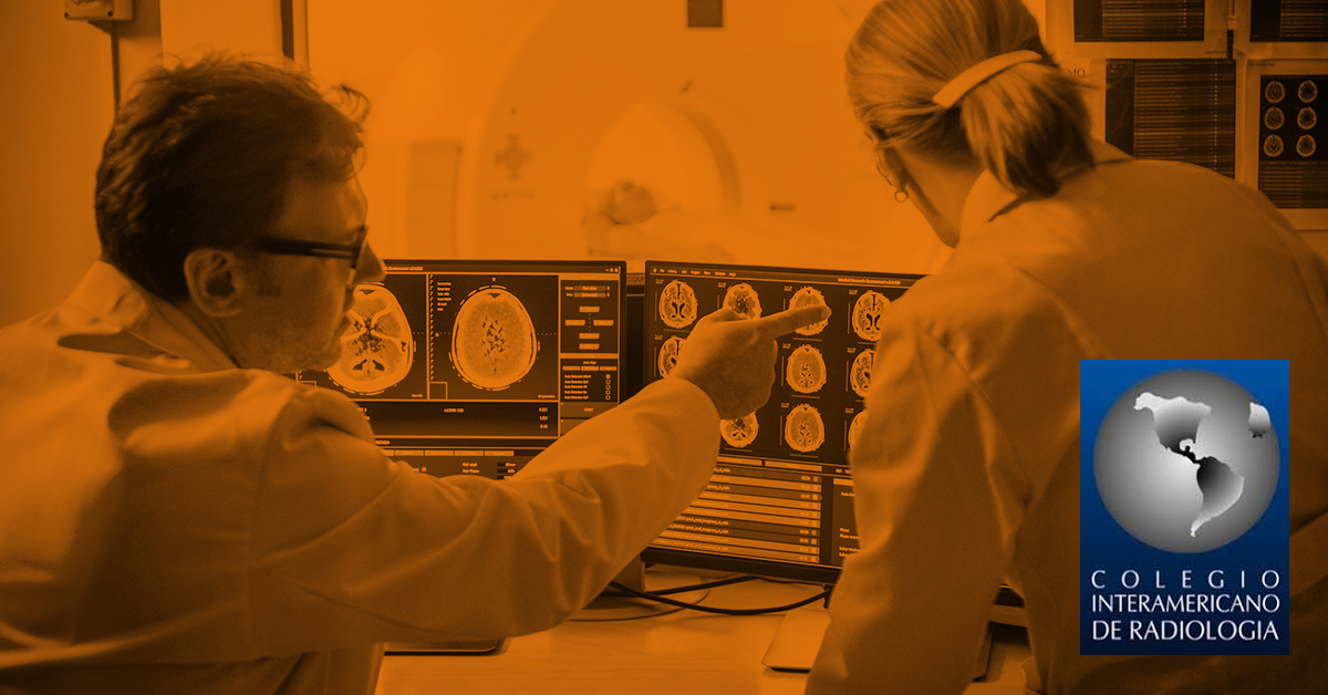 Image of two radiologists evaluating a medical scan.