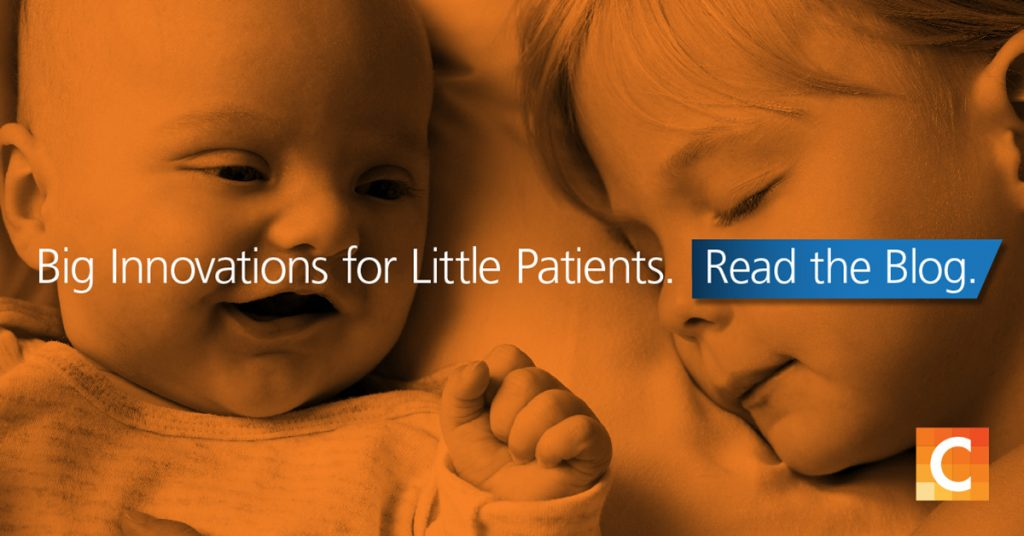 Photo of a baby and young child laying next to each other. Big innovations for little patients written ontop. Carestream logo in bottom right corner.